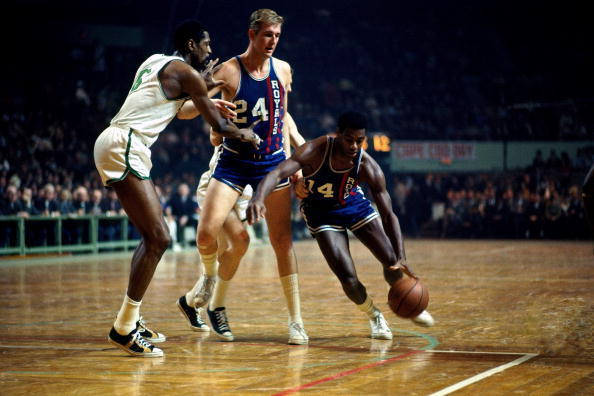 BOSTON - 1967:  Oscar Robertson #14 of the Cincinnati Royals moves the ball against Bill Russell #6 of the Boston Celtics during a game circa 1967 at the Boston Garden in Boston, Massachusetts.  NOTE TO USER: User expressly acknowledges and agrees that, by downloading and/or using this Photograph, user is consenting to the terms and conditions of the Getty Images License Agreement.  Mandatory Copyright Notice: Copyright 1967 NBAE (Photo by Dick Raphael/NBAE via Getty Images)